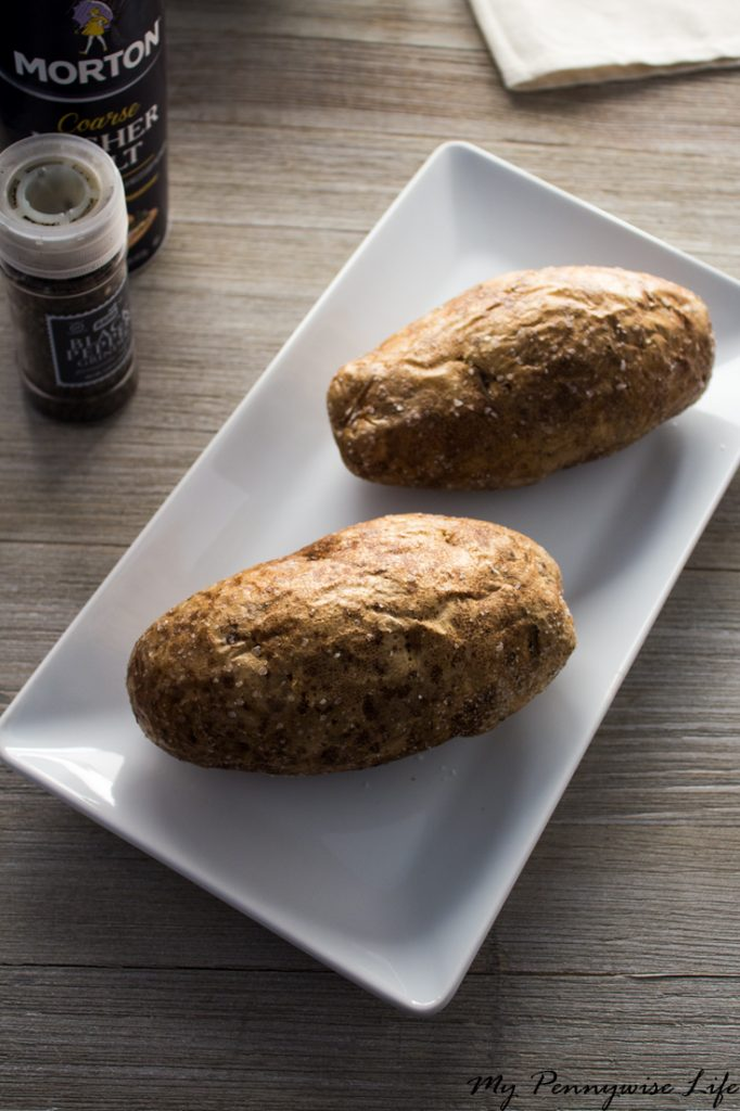 How to Cook the Perfect Baked Potato (Restaurant Style): Cook perfectly fluffy, restaurant style baked potatoes in two easy steps!